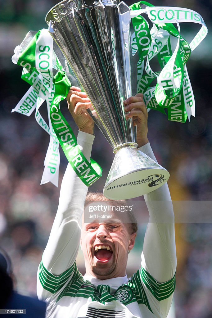 Top scorer Leigh Griffiths of Celtic lifts the trophy for Celtic after winning the Scottish Premiership Match between Celtic and Inverness Caley Thistle at Celtic Park on May 24, 2015 in Glasgow, Scotland.