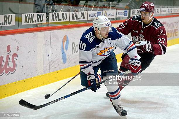 Top scorer of KHL 9th season Sergey Mazyakin of Metallurg Magnitogorsk and Cibulskis Oskars of Dinamo Riga during the game between Dinamo Riga and...