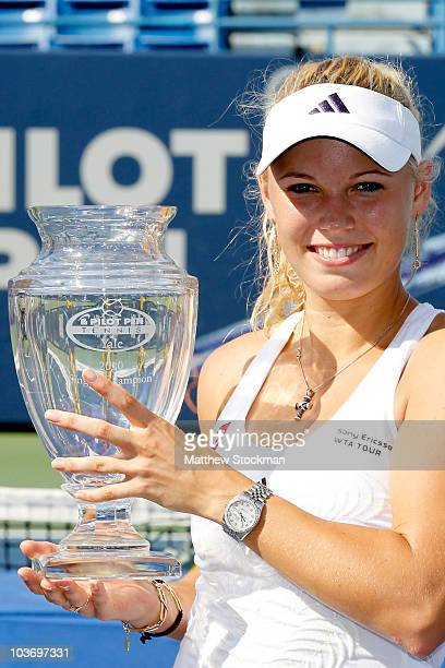 Top seed Caroline Wozniacki of Denmark poses for photographers with her trophy after defeating Nadia Petrova of Russia during the final of the Pilot...