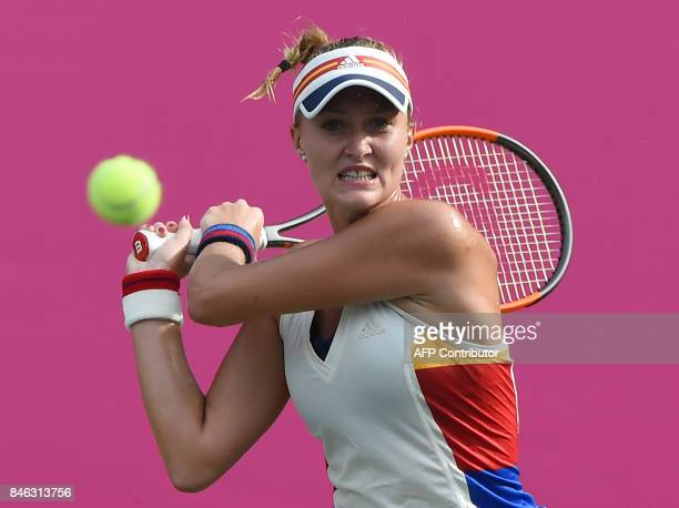 Top seed Kristina Mladenovic of France returns a shot against Jena Fett of Croatia during their first round match of the Japan Women's Open tennis...