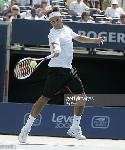 Top seeded Roger Federer of Switzerland in action during his 2nd round match against Sebastien Grosjean of France in the Rogers Cup at the Rexall...