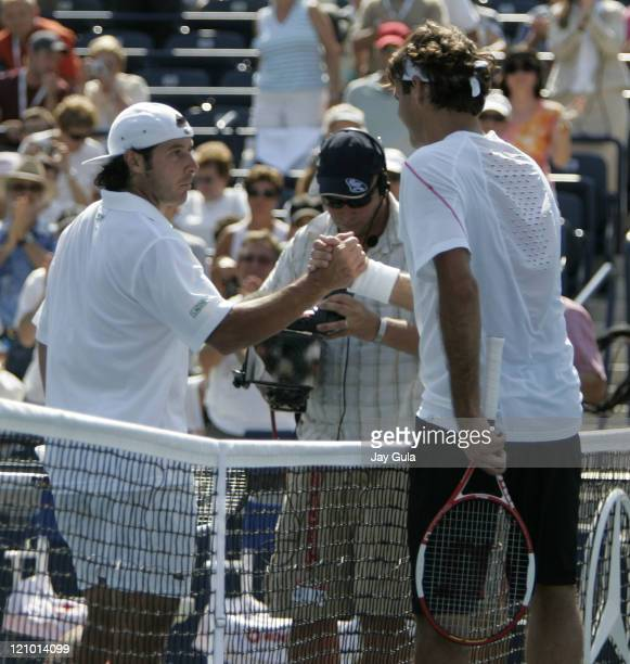 Top seeded Roger Federer of Switzerland shakes hands with Sebastien Grosjean of France after his 2nd round match in the Rogers Cup at the Rexall...