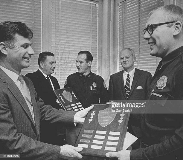 JAN 21 1969 Top Shooters Receive Honors Safety Manager William Koch left front presents the annual Judge Charles E Bennett Award for proficiency in...