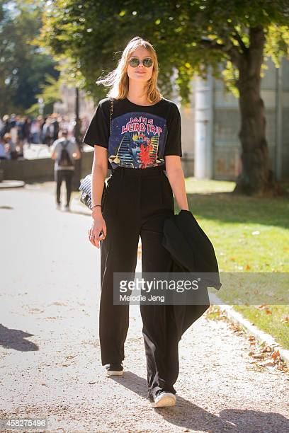 Top Swedish model Frida Gustavsson walks by the Grand Palais museum in a Balenciaga tshirt and Chanel purse on Day 5 of Paris Fashion Week...