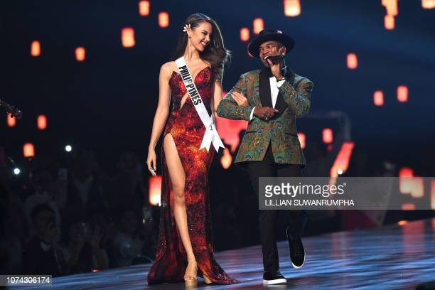 Top three finalist Catriona Gray of the Philippines looks on while US artist NeYo performs on stage during the 2018 Miss Universe Pageant in Bangkok...