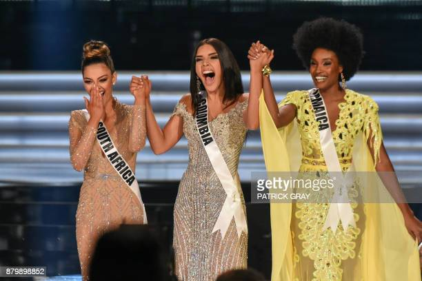 Top three finalists Miss South Africa 2017 DemiLeigh NelPeters Miss Colombia 2017 Laura Gonzalez and Miss Jamaica 2017 Davina Bennett stand on stage...