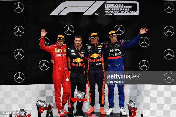 Top three finisher Max Verstappen of Netherlands and Red Bull Racing Sebastian Vettel of Germany and Ferrari and Daniil Kvyat of Russia and Scuderia...