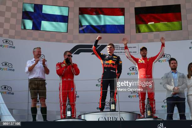 Top three finisher Max Verstappen of Netherlands and Red Bull Racing Kimi Raikkonen of Finland and Ferrari and Sebastian Vettel of Germany and...