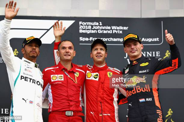 Top three finisher Sebastian Vettel of Germany and Ferrari Lewis Hamilton of Great Britain and Mercedes GP and Max Verstappen of Netherlands and Red...