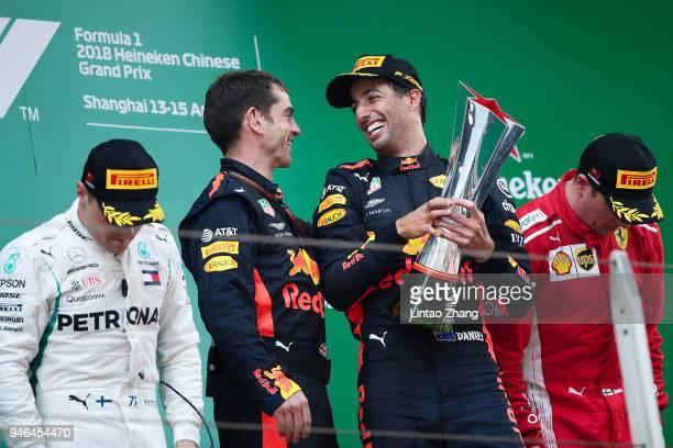Top three finishers Daniel Ricciardo of Australia and Red Bull Racing Valtteri Bottas of Finland and Mercedes GP and Kimi Raikkonen of Finland and...