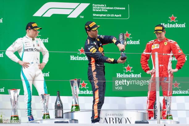 Top three finishers Daniel Ricciardo of Australia and Red Bull Racing Valtteri Bottas of Finland and Mercedes GP and Kimi Raikkonen of Finland and...