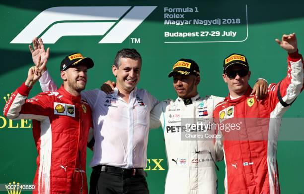 Top three finishers Lewis Hamilton of Great Britain and Mercedes GP Sebastian Vettel of Germany and Ferrari and Kimi Raikkonen of Finland and Ferrari...