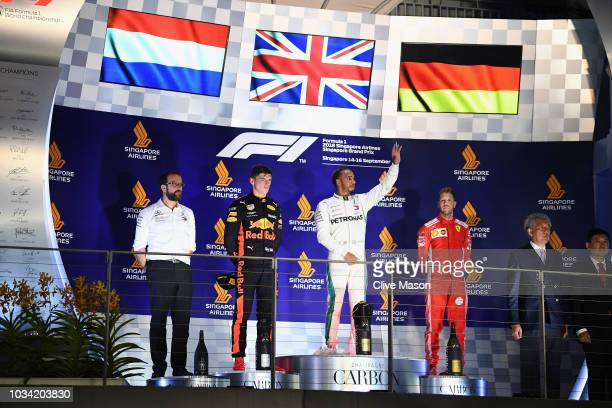 Top three finishers Lewis Hamilton of Great Britain and Mercedes GP Max Verstappen of Netherlands and Red Bull Racing and Sebastian Vettel of Germany...