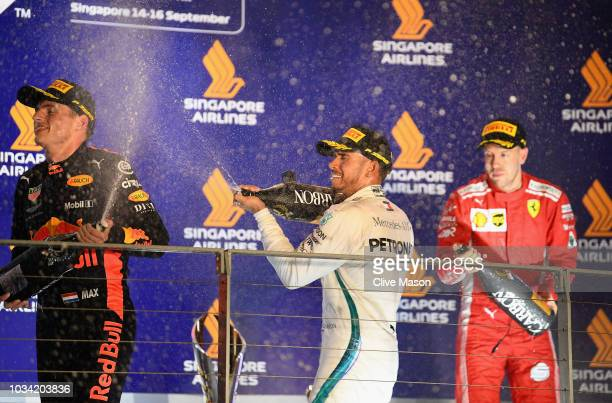 Top three finishers Lewis Hamilton of Great Britain and Mercedes GP , Max Verstappen of Netherlands and Red Bull Racing and Sebastian Vettel of...