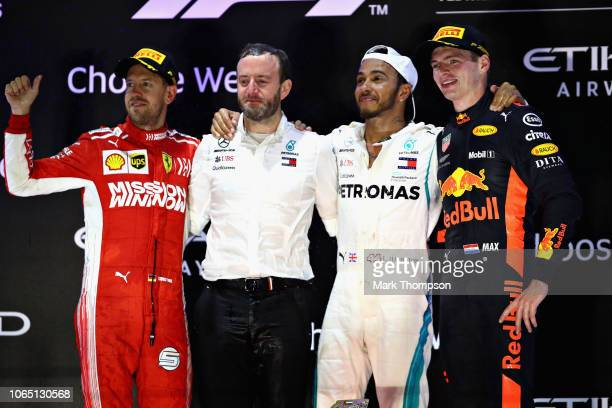 Top three finishers Lewis Hamilton of Great Britain and Mercedes GP Sebastian Vettel of Germany and Ferrari and Max Verstappen of Netherlands and Red...