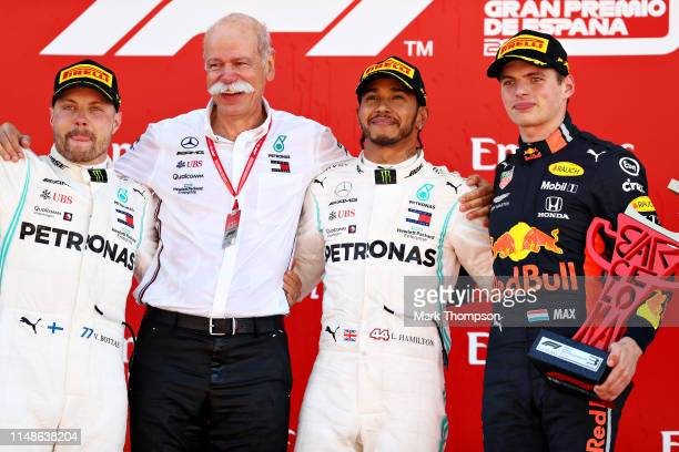 Top three finishers Lewis Hamilton of Great Britain and Mercedes GP Valtteri Bottas of Finland and Mercedes GP and Max Verstappen of Netherlands and...