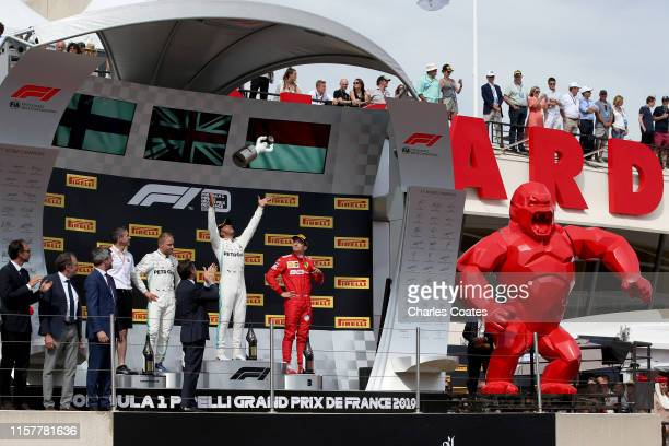 Top three finishers Lewis Hamilton of Great Britain and Mercedes GP Valtteri Bottas of Finland and Mercedes GP and Charles Leclerc of Monaco and...