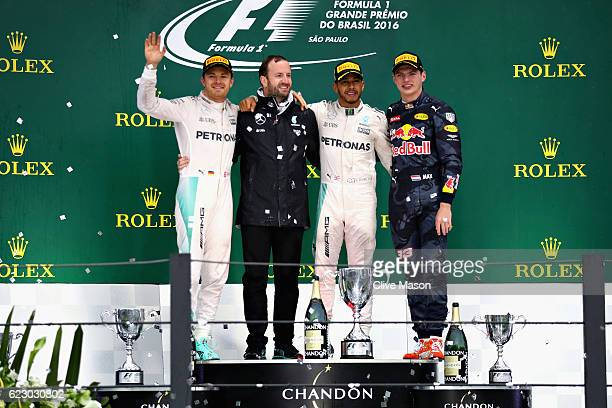 Top three finishers Lewis Hamilton of Great Britain and Mercedes GP Nico Rosberg of Germany and Mercedes GP and Max Verstappen of Netherlands and Red...