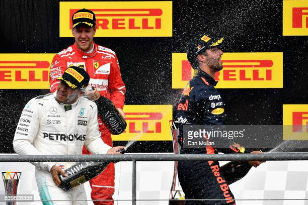 Top three finishers Lewis Hamilton of Great Britain and Mercedes GP Sebastian Vettel of Germany and Ferrari and Daniel Ricciardo of Australia and Red...
