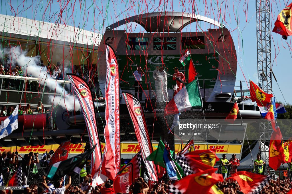 Top three finishers Lewis Hamilton of Great Britain and Mercedes GP, Valtteri Bottas of Finland and Mercedes GP and Sebastian Vettel of Germany and Ferrari celebrate on the podium during the Formula One Grand Prix of Italy at Autodromo di Monza on September 3, 2017 in Monza, Italy.