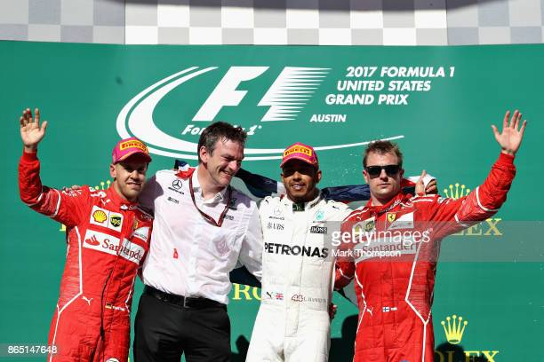 Top three finishers Lewis Hamilton of Great Britain and Mercedes GP Sebastian Vettel of Germany and Ferrari Kimi Raikkonen of Finland and Ferrari and...