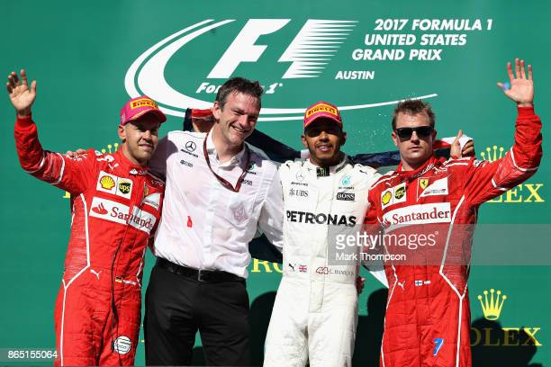 Top three finishers Lewis Hamilton of Great Britain and Mercedes GP Sebastian Vettel of Germany and Ferrari Kimi Raikkonen of Finland and Ferrari and...