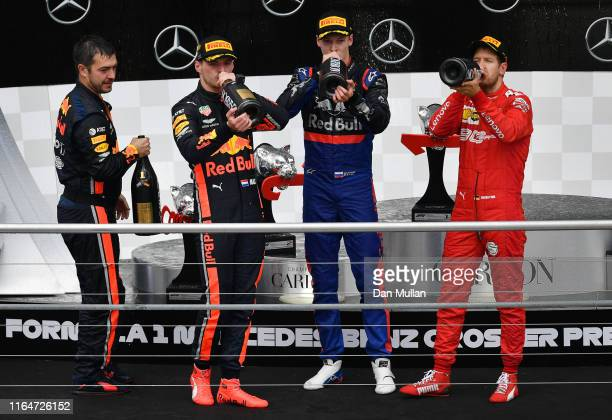 Top three finishers Max Verstappen of Netherlands and Red Bull Racing Sebastian Vettel of Germany and Ferrari and Daniil Kvyat of Russia and Scuderia...