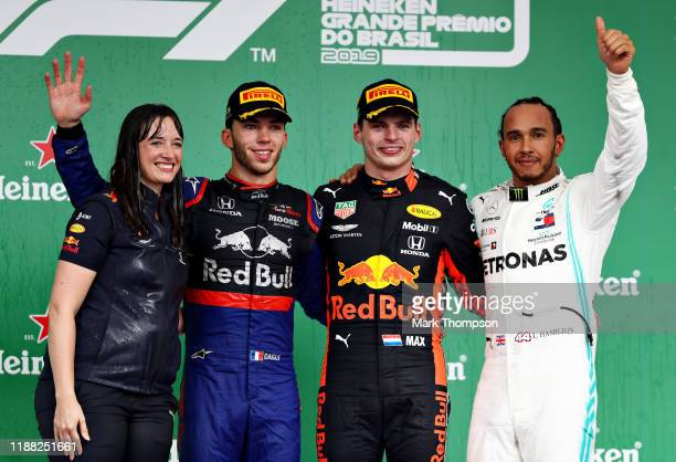 Top three finishers Max Verstappen of Netherlands and Red Bull Racing Pierre Gasly of France and Scuderia Toro Rosso and Lewis Hamilton of Great...