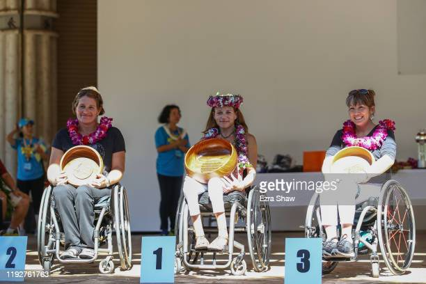 Top three finishers of the Women's wheelchair race are on the podium, Dawna Zane of the USA, third place, Megan O'Neil of USA first place and...