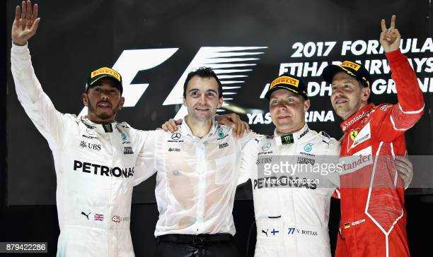 Top three finishers Valtteri Bottas of Finland and Mercedes GP Lewis Hamilton of Great Britain and Mercedes GP and Sebastian Vettel of Germany and...