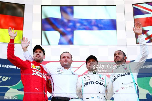 Top three finishers Valtteri Bottas of Finland and Mercedes GP, Sebastian Vettel of Germany and Ferrari and Lewis Hamilton of Great Britain and...