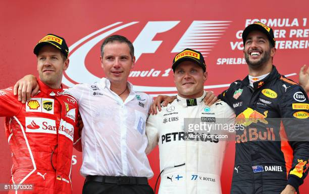 Top three finishers Valtteri Bottas of Finland and Mercedes GP Sebastian Vettel of Germany and Ferrari and Daniel Ricciardo of Australia and Red Bull...