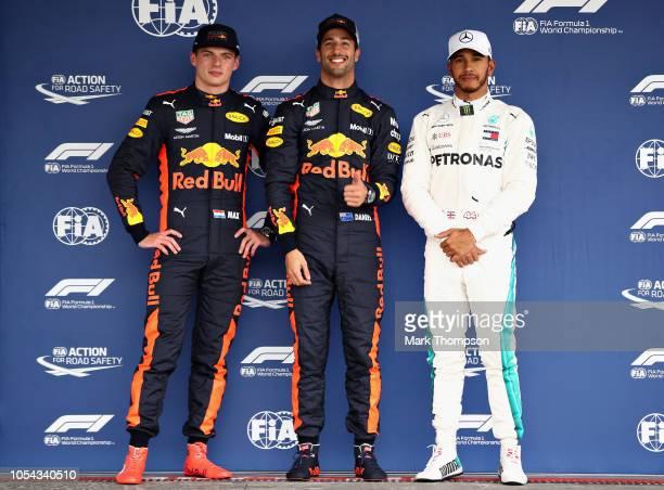 Top three qualifiers Daniel Ricciardo of Australia and Red Bull Racing Max Verstappen of Netherlands and Red Bull Racing and Lewis Hamilton of Great...