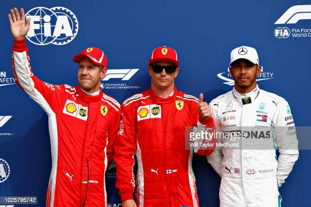 Top three qualifiers Kimi Raikkonen of Finland and Ferrari Sebastian Vettel of Germany and Ferrari and Lewis Hamilton of Great Britain and Mercedes...