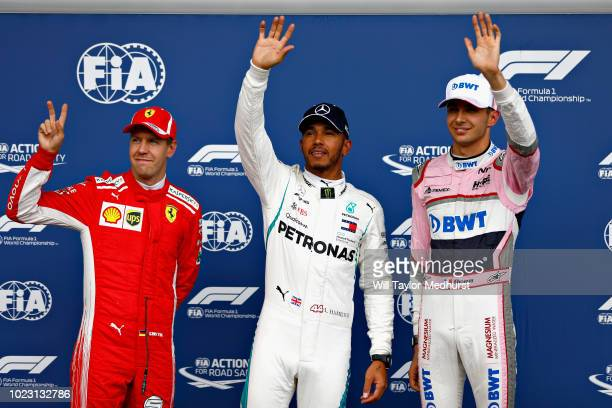 Top three qualifiers Lewis Hamilton of Great Britain and Mercedes GP Sebastian Vettel of Germany and Ferrari and Esteban Ocon of France and Force...