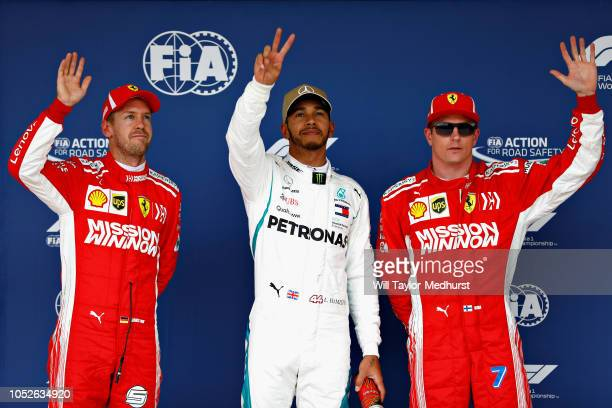 Top three qualifiers Lewis Hamilton of Great Britain and Mercedes GP, Sebastian Vettel of Germany and Ferrari and Kimi Raikkonen of Finland and...