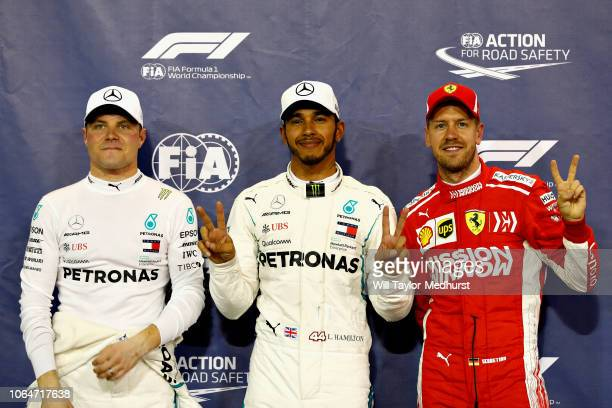 Top three qualifiers Lewis Hamilton of Great Britain and Mercedes GP Valtteri Bottas of Finland and Mercedes GP and Sebastian Vettel of Germany and...