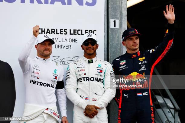 Top three qualifiers Lewis Hamilton of Great Britain and Mercedes GP Valtteri Bottas of Finland and Mercedes GP and Max Verstappen of Netherlands and...