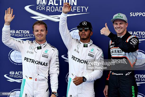 Top three qualifiers Lewis Hamilton of Great Britain and Mercedes GP Nico Rosberg of Germany and Mercedes GP and Nico Hulkenberg of Germany and Force...