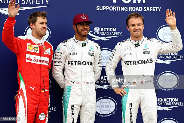Top three qualifiers Lewis Hamilton of Great Britain and Mercedes GP Nico Rosberg of Germany and Mercedes GP and Sebastian Vettel of Germany and...