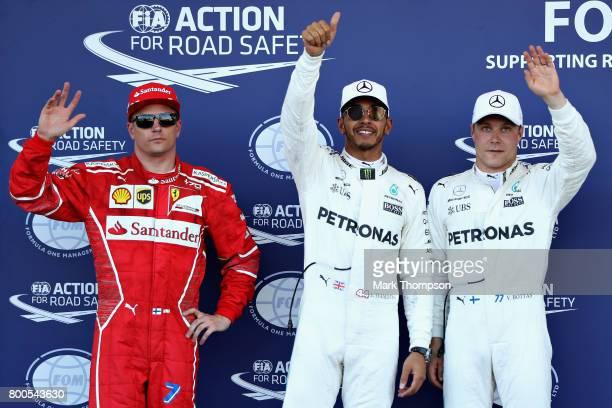 Top three qualifiers Lewis Hamilton of Great Britain and Mercedes GP Valtteri Bottas of Finland and Mercedes GP and Kimi Raikkonen of Finland and...