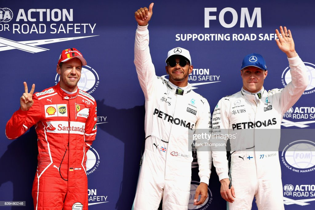 Top three qualifiers Lewis Hamilton of Great Britain and Mercedes GP, Sebastian Vettel of Germany and Ferrari and Valtteri Bottas of Finland and Mercedes GP wave to the crowd during qualifying for the Formula One Grand Prix of Belgium at Circuit de Spa-Francorchamps on August 26, 2017 in Spa, Belgium.