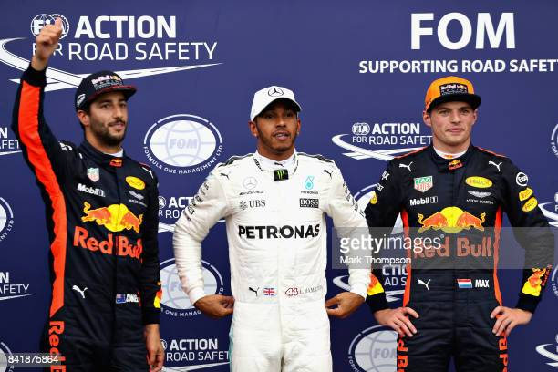 Top three qualifiers Lewis Hamilton of Great Britain and Mercedes GP Daniel Ricciardo of Australia and Red Bull Racing and Max Verstappen of...