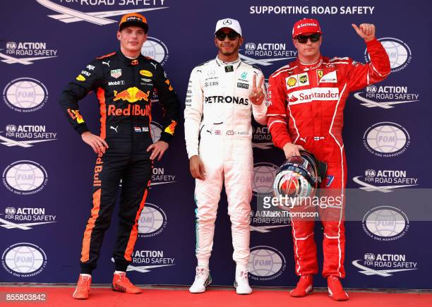 Top three qualifiers Lewis Hamilton of Great Britain and Mercedes GP Kimi Raikkonen of Finland and Ferrari and Max Verstappen of Netherlands and Red...