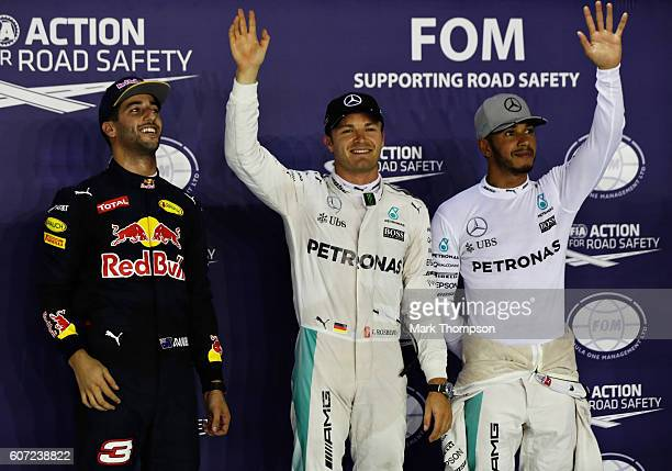 Top three qualifiers Nico Rosberg of Germany and Mercedes GP Daniel Ricciardo of Australia and Red Bull Racing and Lewis Hamilton of Great Britain...