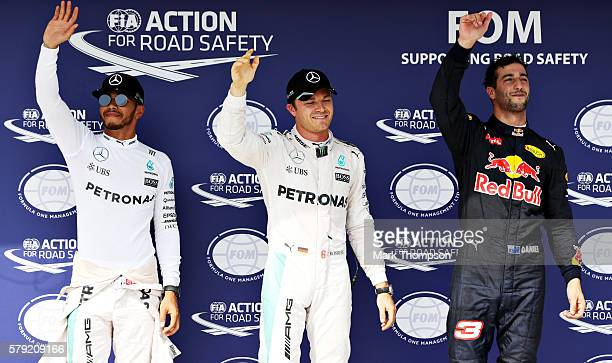 Top three qualifiers Nico Rosberg of Germany and Mercedes GP Lewis Hamilton of Great Britain and Mercedes GP and Daniel Ricciardo of Australia and...