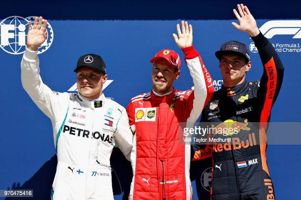 Top three qualifiers Sebastian Vettel of Germany and Ferrari vValtteri Bottas of Finland and Mercedes GP nd Max Verstappen of Netherlands and Red...
