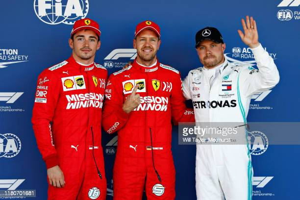 Top three qualifiers Sebastian Vettel of Germany and Ferrari, Charles Leclerc of Monaco and Ferrari and Valtteri Bottas of Finland and Mercedes GP...