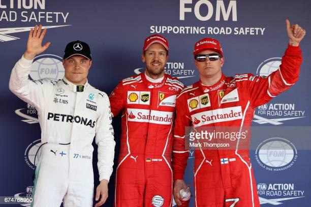 Top three qualifiers Sebastian Vettel of Germany and Ferrari Kimi Raikkonen of Finland and Ferrari and Valtteri Bottas of Finland and Mercedes GP in...
