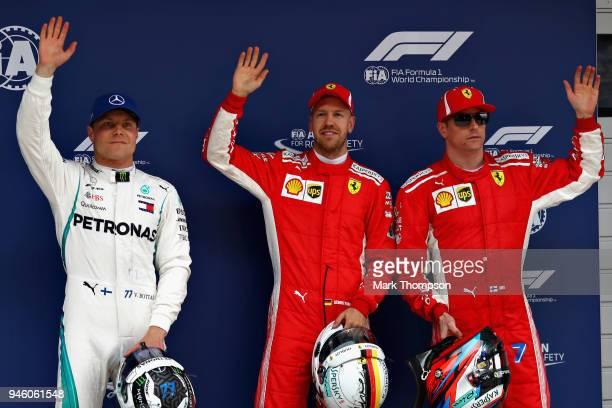 Top three qualifiers Sebastian Vettel of Germany and Ferrari Kimi Raikkonen of Finland and Ferrari and Valtteri Bottas of Finland and Mercedes GP...